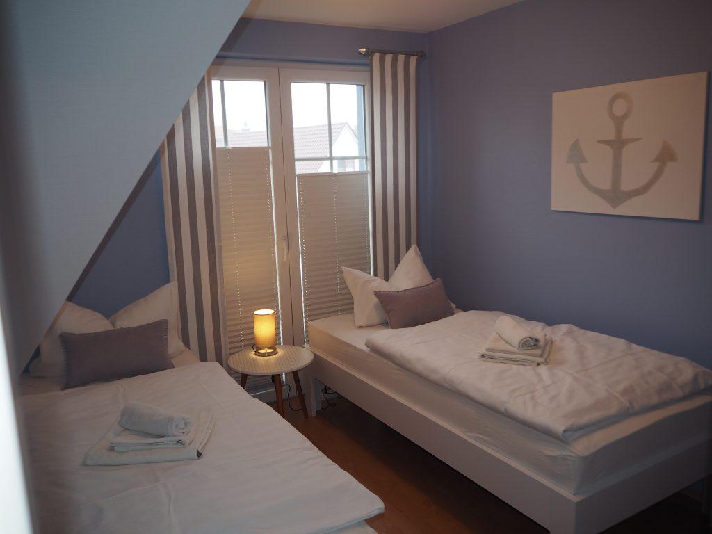 Schlafzimmer blau, Ferienhaus Windflüchter